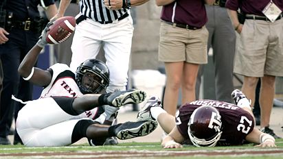 Robert Johnson's last-second touchdown catch floored the Aggies. David J. Phillip/AP Photo